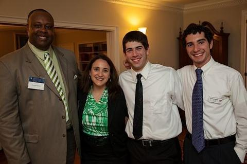 Guests at Timothy Dwight College House pose at reception for Leonel Fernández