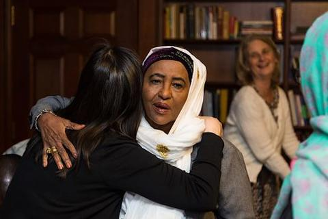 Mary Lui greets Hawa Abdi at Timothy Dwight College House