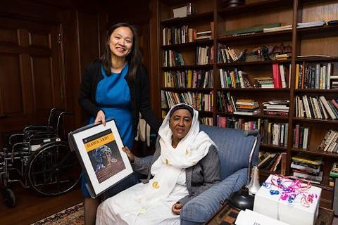 Mary Lui presents Hawa Abdi with a gift from The Chubb Fellowship