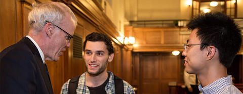 Students talking to a Chubb Fellow Bill McKibben