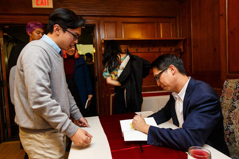 Gene Yang signs books for students at Timothy Dwight College Dining Hall